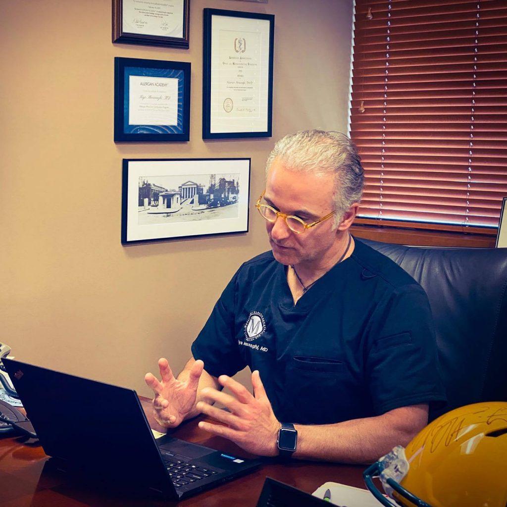Dr. Kiya Movassaghi performing a virtual consultation at his Eugene plastic surgery practice
