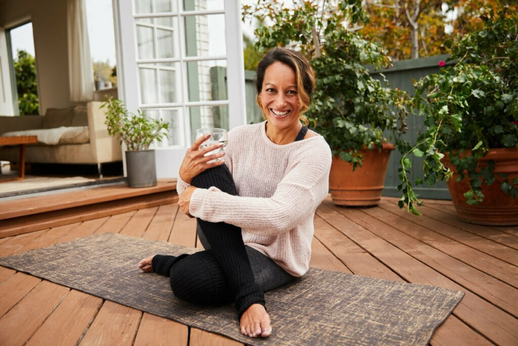 Mature Woman Practicing Yoga Enjoying Some Non-Aesthetic Benefits of Plastic Surgery